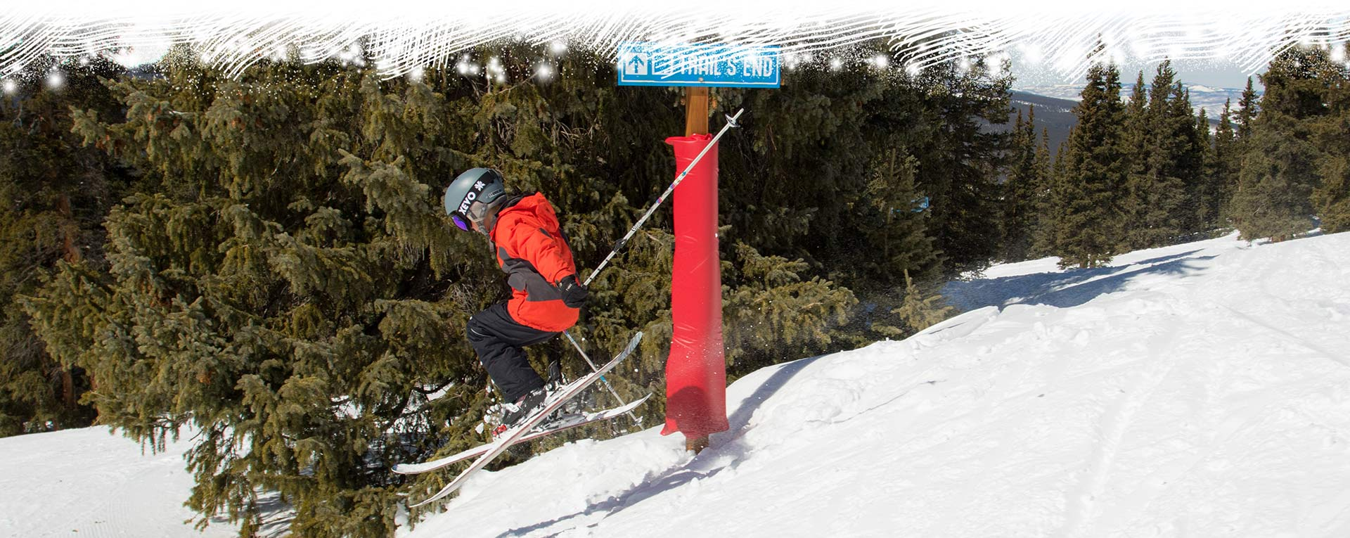 young skier mid-jump