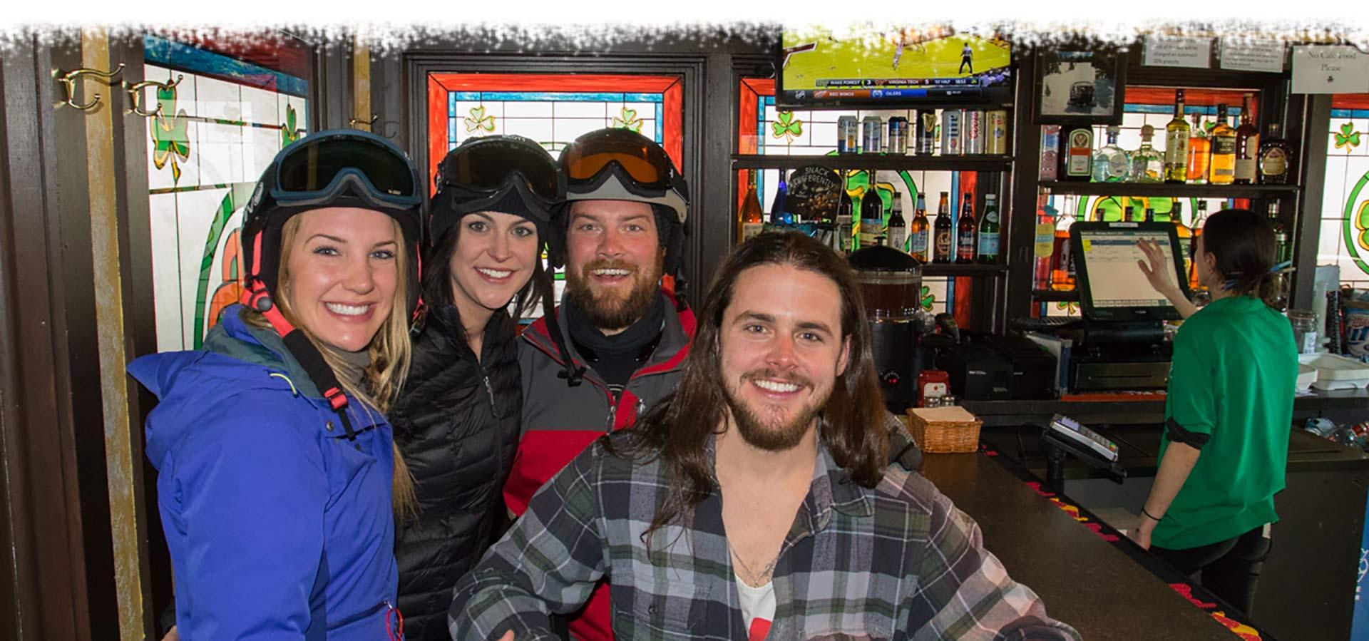 skiers smiling in katie o'rourke's irish pub