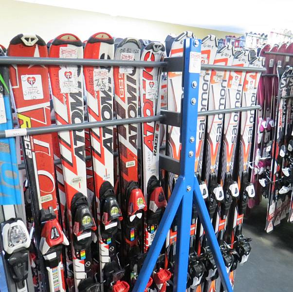 rental skis on a rack