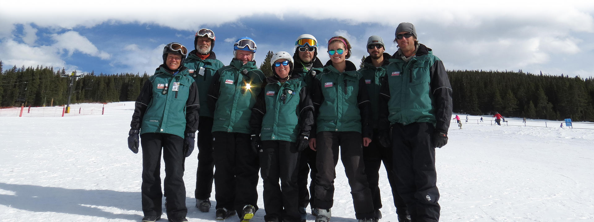 ski instructors posing on a slope