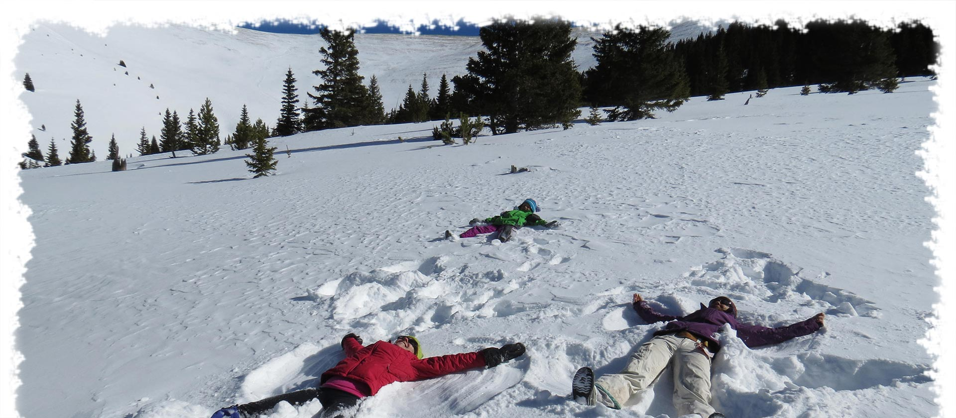 kids making snow angels on chicago ridge