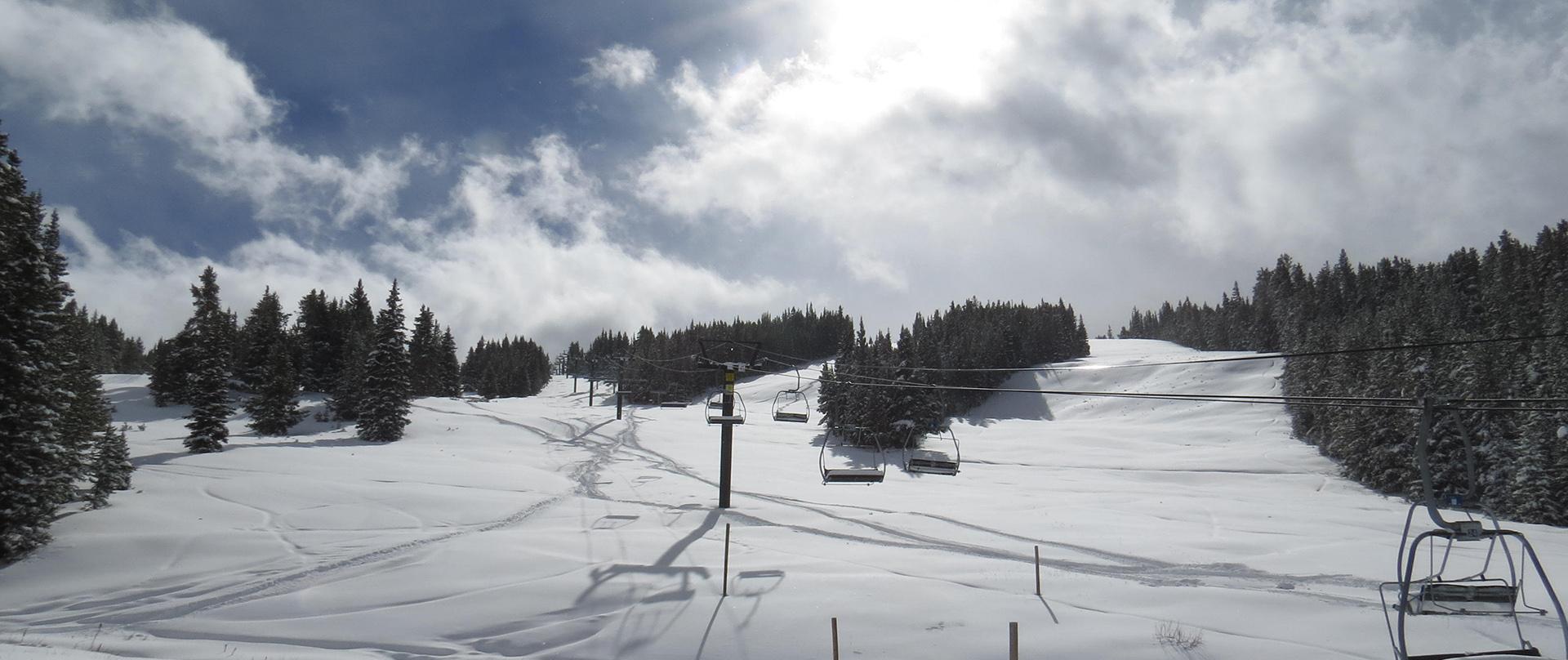snowy runs near the triple chair