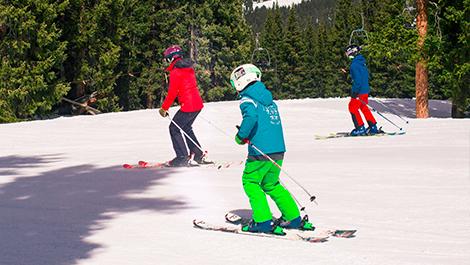 family of three skiing