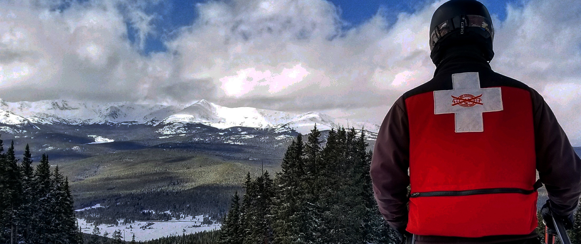 Ski Patroller looking at a view of the mountains