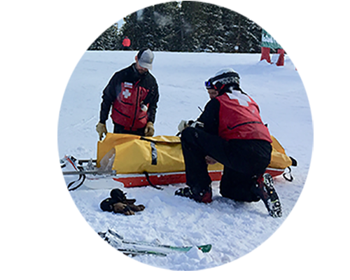 Ski patrollers and sled