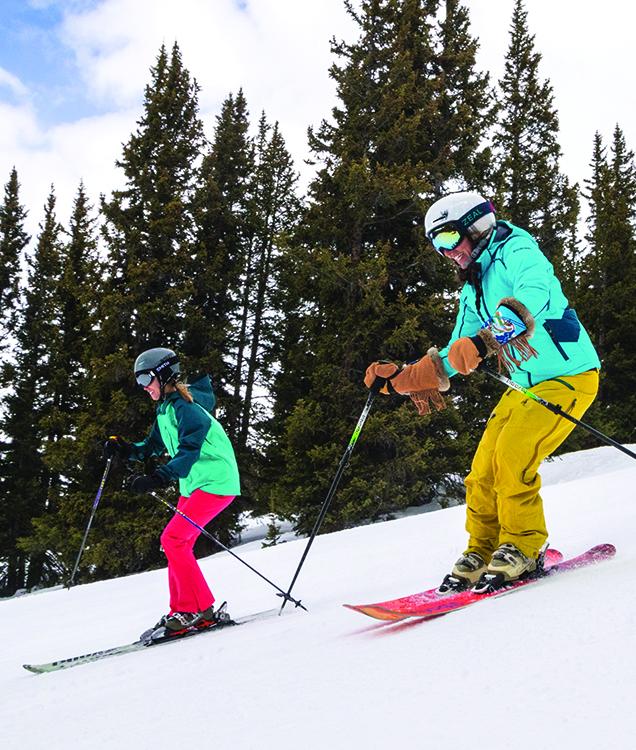 Two girls skiing