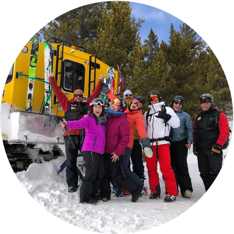 Group of people outside a snowcat