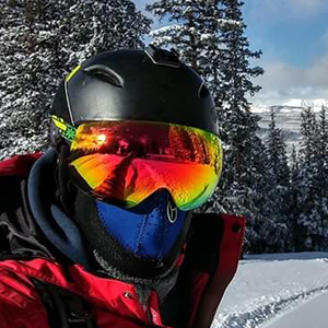 Snowboarder with a mask on